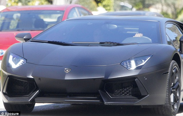Nice ride: He waited in the Lamborghini while she grabbed her eats