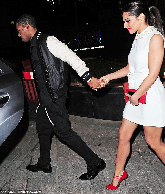 Hold on tight: Tre held on tightly to Cheryl's hand as they left the venue