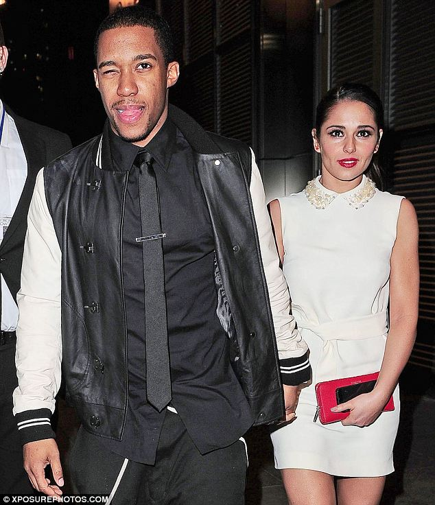 Cheeky: Tre Holloway winked as he left a restaurant with Cheryl Cole on Valentine's Day