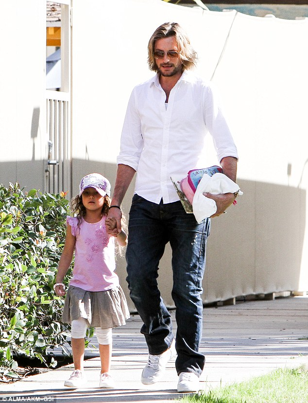 Doting dad: Gabriel Aubry held his daughter's hand tightly after he picked her up from school on Friday in Beverly Hills