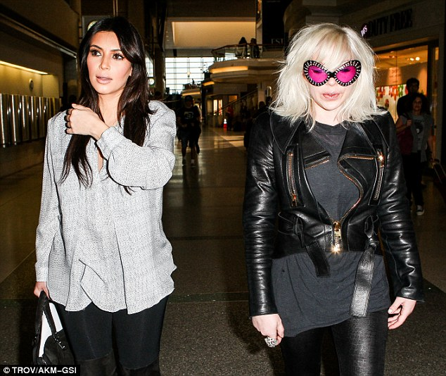 Secret weapon: Kim was accompanied in the LAX terminal by Joyce Bonelli, her eccentric make-up artist and friend since 2005