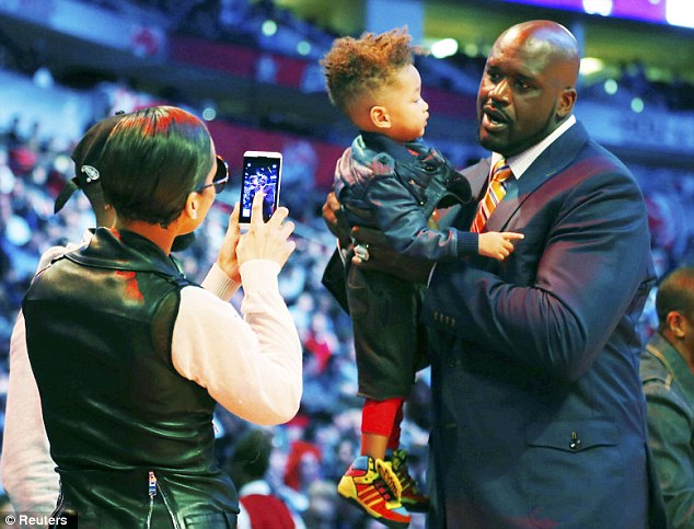 Say cheese: Alicia took a picture of her son Egypt Daoud Dean with NBA legend Shaquille O'Neal during the All-Star weekend in Houston
