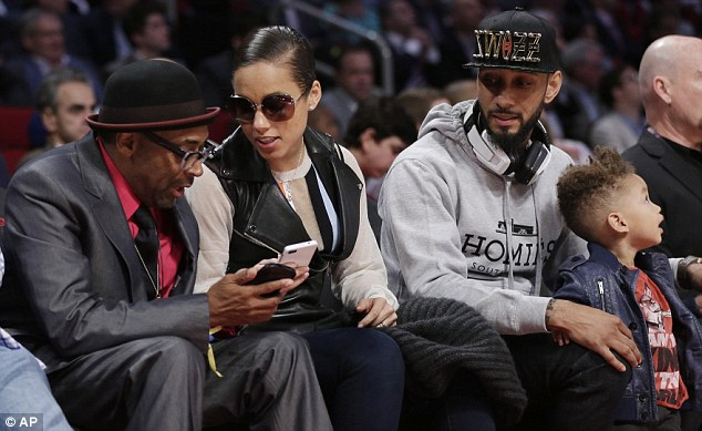 How about that then? Alicia shows legendary director Spike Lee the picture of her son with Shaquille O'Neil