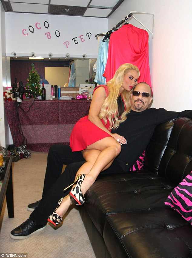 Endearing: Coco made herself comfortable on Ice-T's lap ahead of her Peepshow performance
