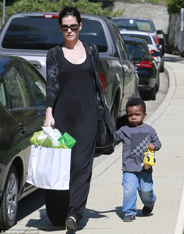 Toys are us: Louis even brought his yellow toy truck to share with Charlize's son Jackson