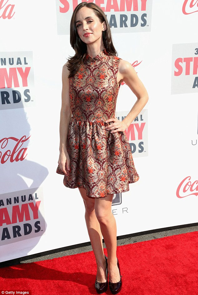 Figure flashing: Eliza Dushku wore an usual high-necked dress to the Streamy Awards at the Hollywood Palladium in Hollywood on Sunday
