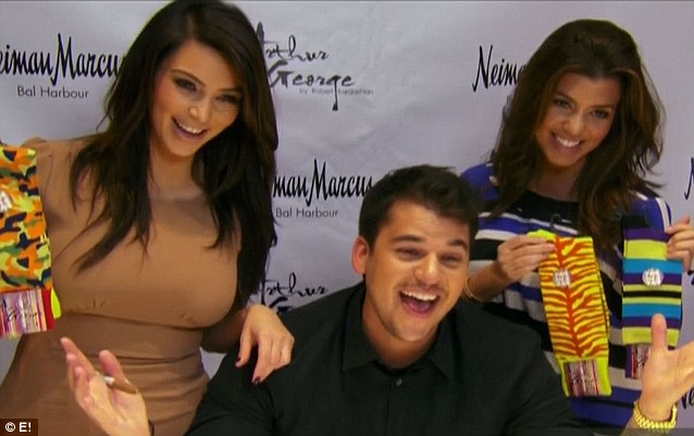 No sibling rivalry: Kourtney and Kim then supported him at his Neiman Marcus sock line launch