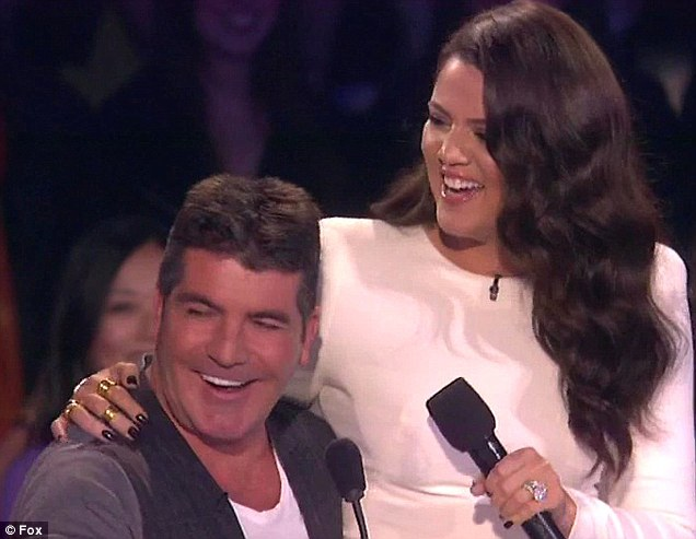 Failed to hit the spot: Khloe's antics included sitting herself on Simon Cowell's lap during a live show and asking if he was excited