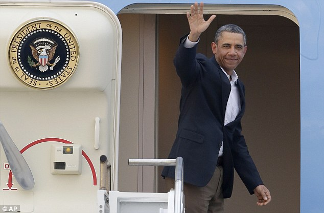 Back in the swing of things: President Obama waves in the doorway of Air Force One as he departs from Palm Beach International Airport on Monday