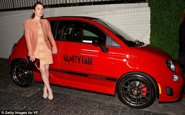 Posing up: Zoe Lister-Jones leaned against the car for added sex appeal