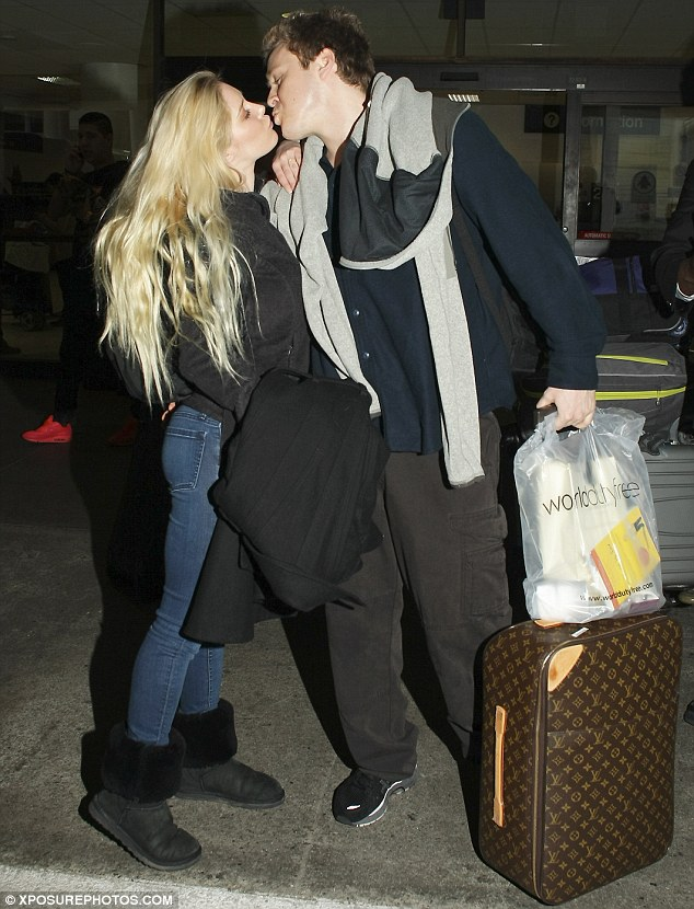 Happily married: Heidi and Spencer show their affection for each other after arriving back in America following their recent Celebrity Big Brother appearance but admit fame and attention has sometimes left them feeling unsafe