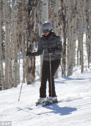 Hitting the slopes: Michelle Obama and her daughters have spent Presidents Day weekend skiing in Aspen, Colorado. This picture shows the First Lady at the same resort last year