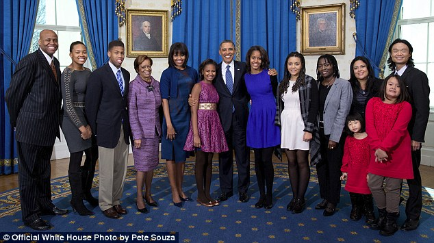 Reunion: Members of the Obama's extended family from left: Craig Robinson, Leslie Robinson, Avery Robinson, Marian Robinson, Akinyi Manners, Auma Obama, Maya Soetoro-Ng, Konrad Ng, Savita Ng, and Suhaila Ng