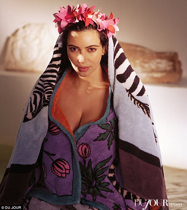 Dryiong off: The photoshoot had a Tahitian princess theme, which Kim models with a floral headdress