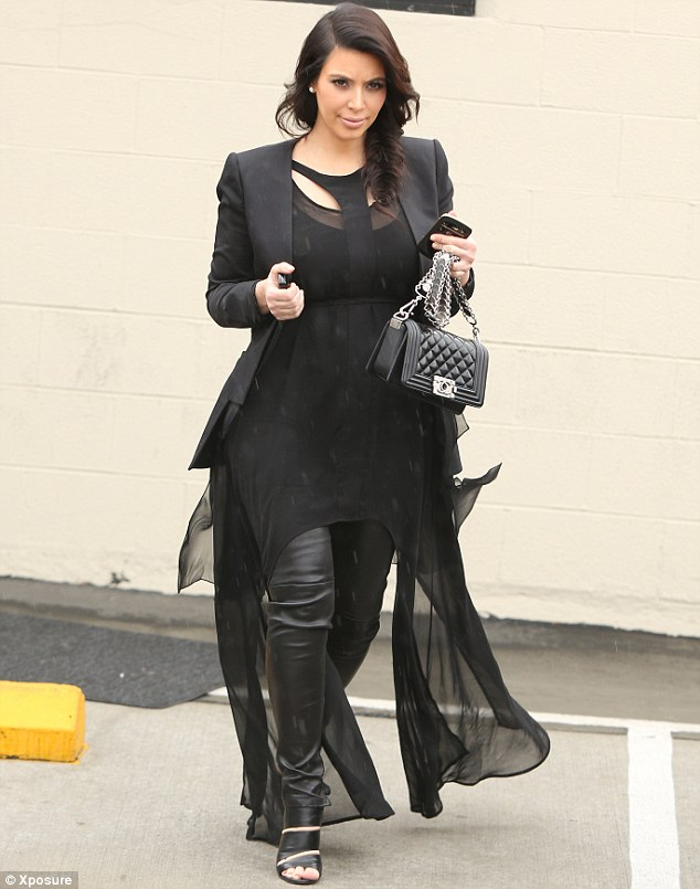 Flattering: Kim's floaty outfit skims her growing bump without revealing it
