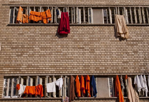 Unhappy home: Clothes hang out of prison cells at the Pretoria Central Prison.The giant facility on the outskirts of the capital crams 17 narrow bunk beds into communal cells measuring around 100ft by 30ft