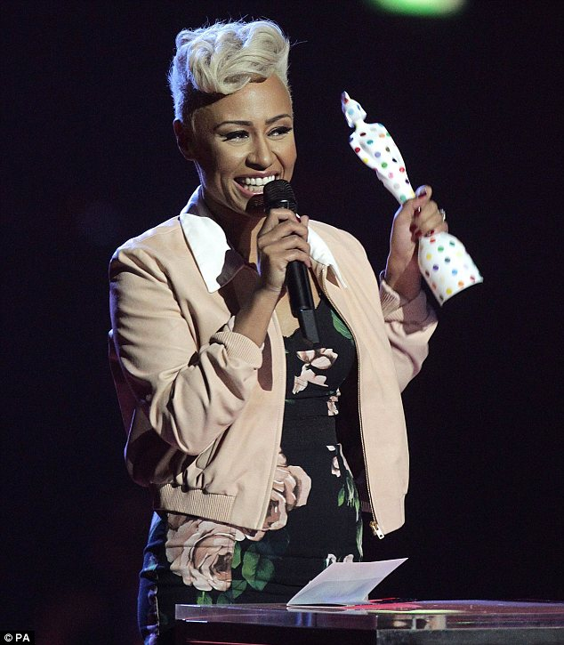 Blooming lovely: Emeli changed from her all-black outfit into a floral dress with a cropped dusty pink jacket