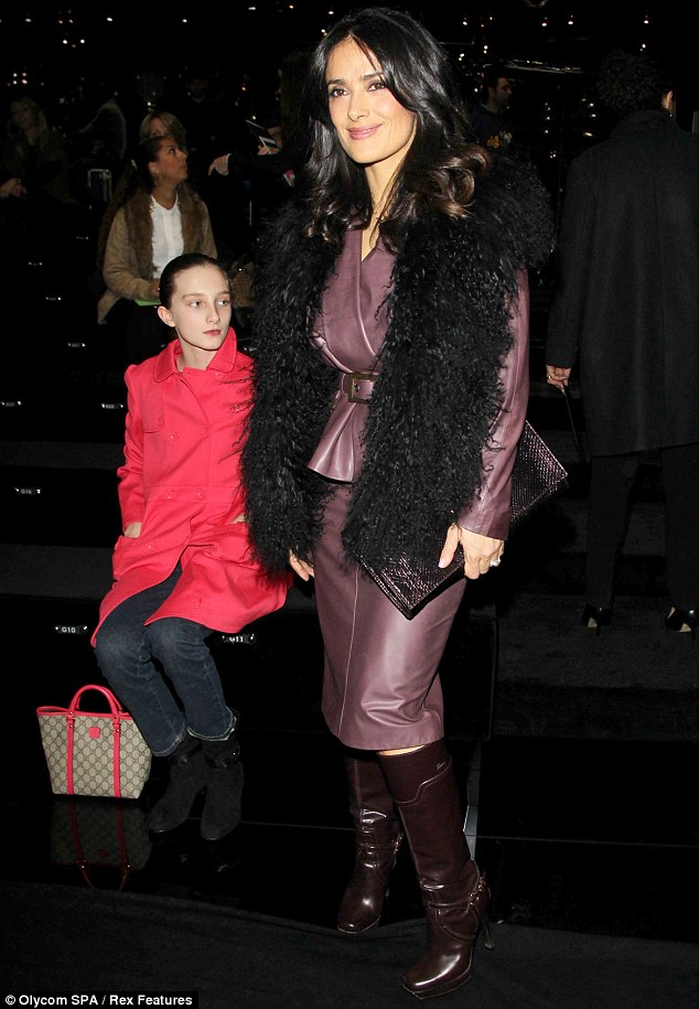 Showing it off: She oozed confidence in the get-up as step daughter Mathilde sat near her
