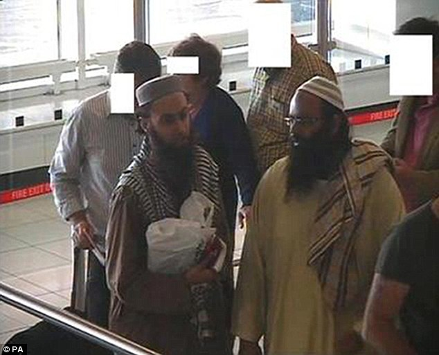 Bearded Islamic savages heading to terror training camps Plot: Irfan Khalid and Irfan Naseer arrive at Birmingham airport before heading to Pakistan for terrorist training