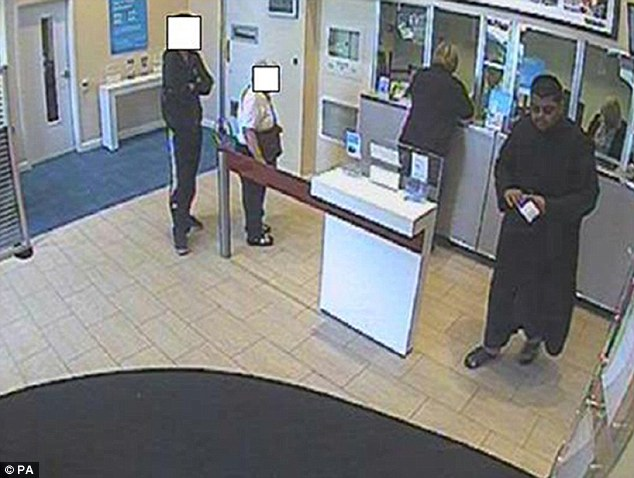 Scam: CCTV shows Rahin Ahmed depositing charity money they had fraudulently taken at a Barclays Bank in Moseley, Birmingham