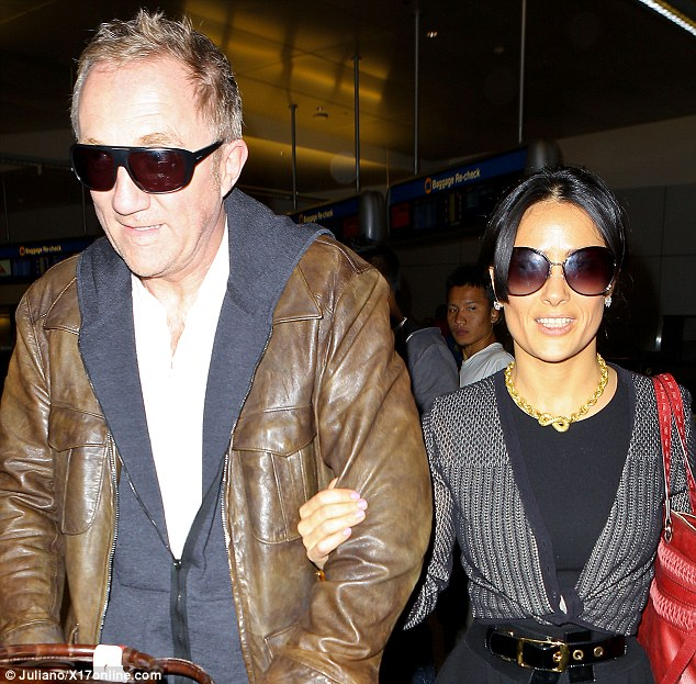 Handsome couple: Salma chose a chunky necklace for her arrival in LAX