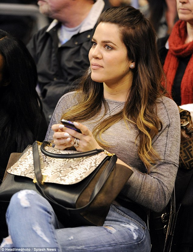 Not a good luck charm: While Khloe looked radiant her presence did not help Lamar's team who lost to Dallas
