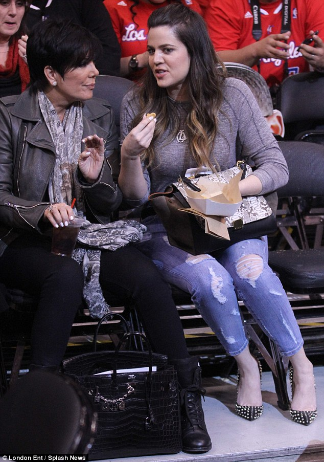 Yum, yum: Khloe did not care who was watching as she chowed down while husband Lamar Odom played