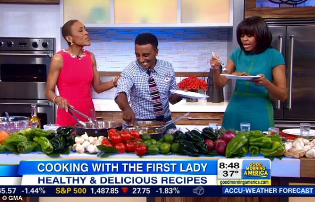 In the kitchen: The first lady joined Robin Roberts and chef Marcus Robert Samuelsson to cook a healthy meal