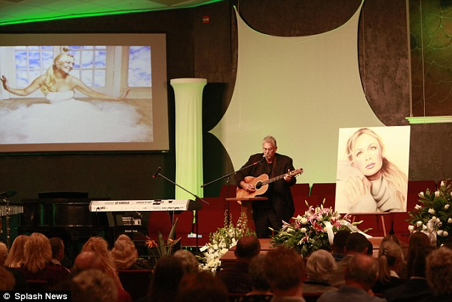 Mindy McCready's stepfather Michael Inge played his guitar and sang Bobby Helms's 'You Are My Special Angel'.