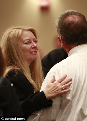 Gayle Inge welcomes mourners to her daughters funeral today at the Crossroads Baptist Church in Fort Myers, Florida
