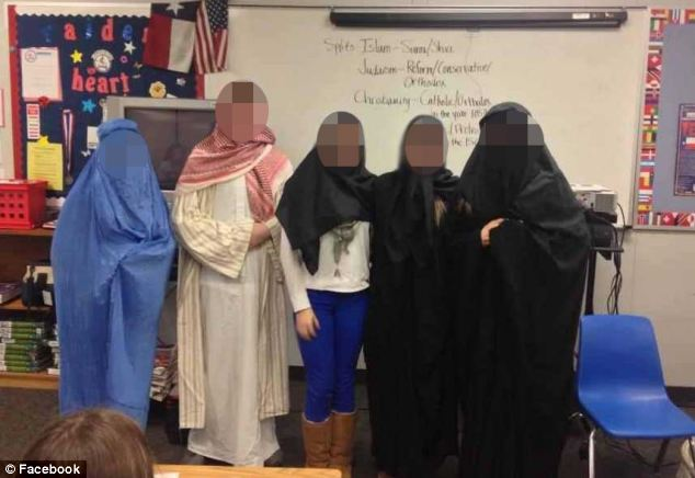 A Texas high school has come in for criticism from parents and a state governor after this photograph of students dressed in burqas appeared on Facebook