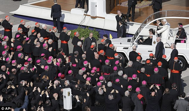Blessing: Cardinals and bishops applaud as the Popemobile drives past in St. Peter's Square