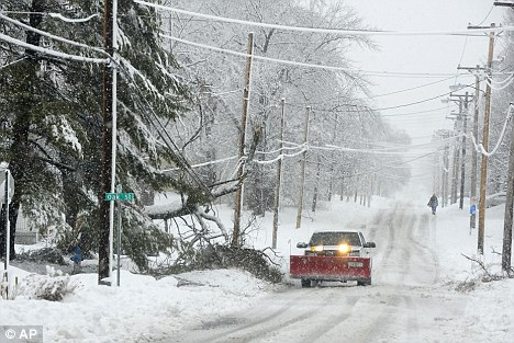 Spending: Behind January's reported increase in consumer spending are reasons of a cold snap that raised utility spending, the streets of central Columbia, Missouri seen, though a decline in goods