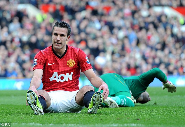 Almost: Robin van Persie sits on the turf at Old Trafford
