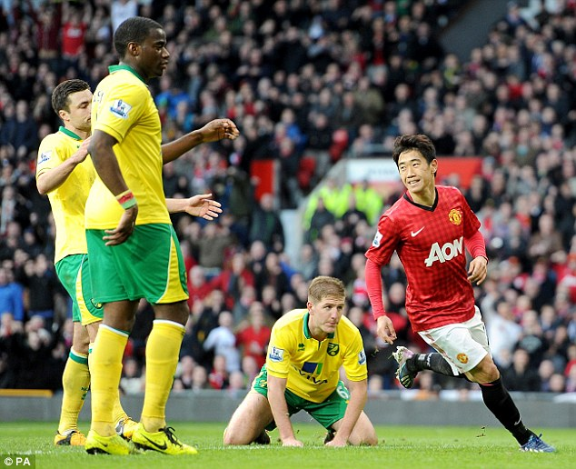 Just like that: Kagawa rushed to celebrate with Rooney after netting his second of the day
