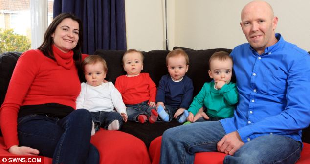 Left to right, mother Emma Robbins with her sons Reuben, Joshua, Zachary and Sammy and husband Martin at home in Bristol