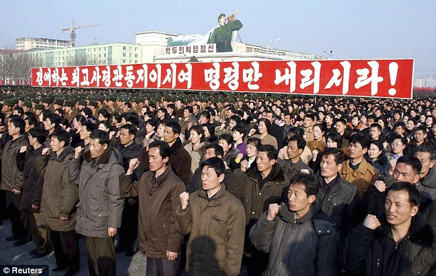 Blind obedience: North Koreans attend a political rally earlier this week. Criticism of the ruling communist regime is strictly forbidden
