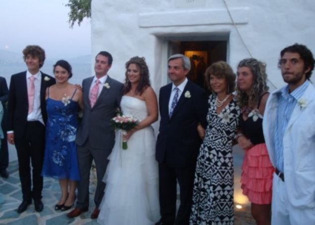 Line-up: Vicky Pryce links arms with her husband Chris Huhne as a family photo is taken after the ceremony in Varkiza - the 'Athens Riviera'