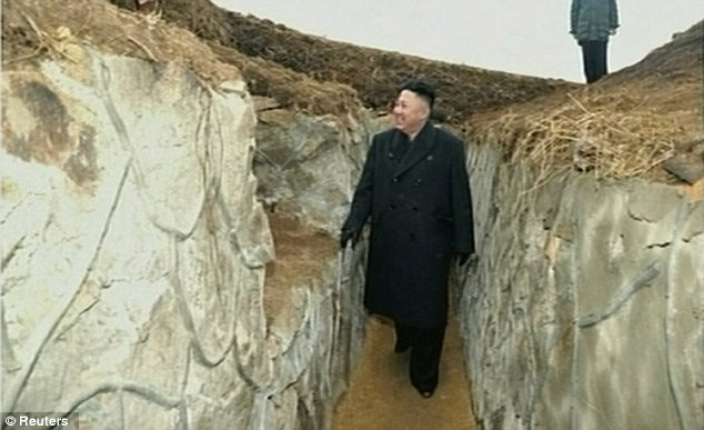 In the trenches: Kim wanders around a military installation in footage broadcast on North Korean TV