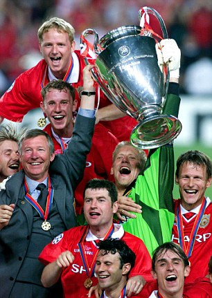That unforgettable night in Barcelona: Giggs and Neville are at the forefront of United's celebrations after a famous win against Bayern Munich