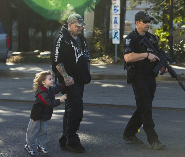 A Seattle Swat Team Member Escorts Thomas Johnson Center And His Son Dameonle
