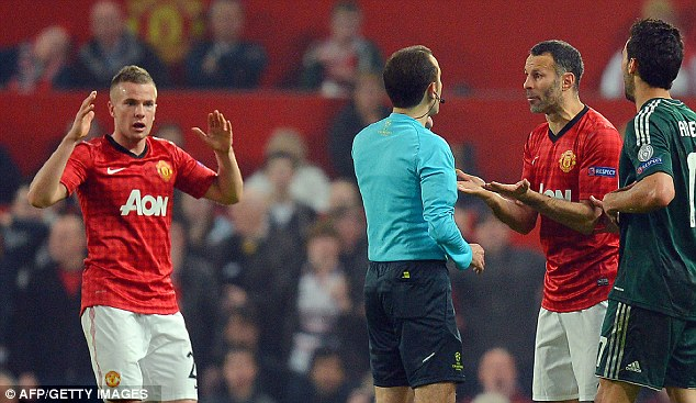 Incredulous: Giggs expresses his disbelief at official Cuneyt Cakir at Nani's sending off