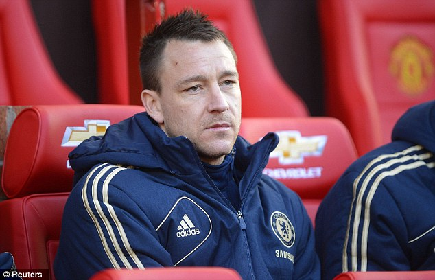 Dejected: John Terry was forced to watch Chelsea's FA Cup exit from the bench