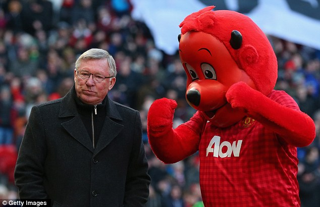 Better the devil you know: Sir Alex Ferguson walks with mascot Fred the Red