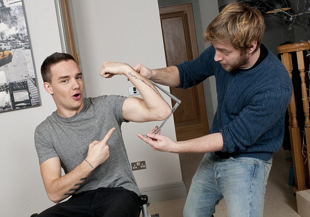 An arm and a leg: Liam poses for his wax figure