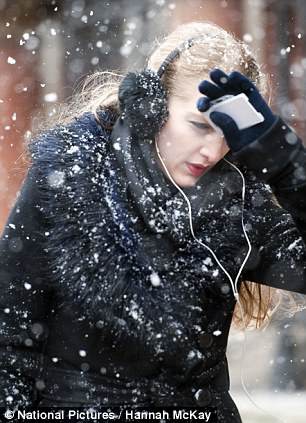 Commuters in the snow in central London this morning