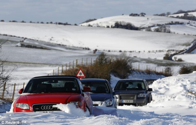 Going nowhere: Cars are stuck in snow on the South Downs near Brighton following heavy snowfall