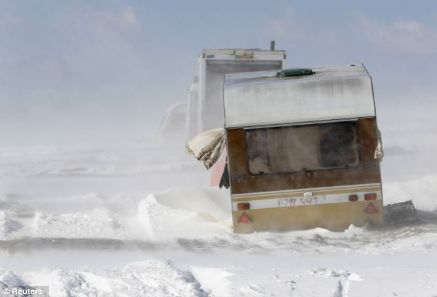 Stranded: An abandoned caravan is buffeted by winds and drifting snow on the South Downs near Brighton