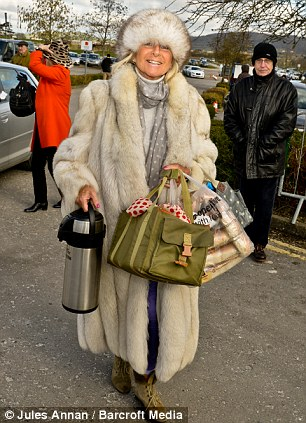 Lady wears her fur coat at Cheltenham