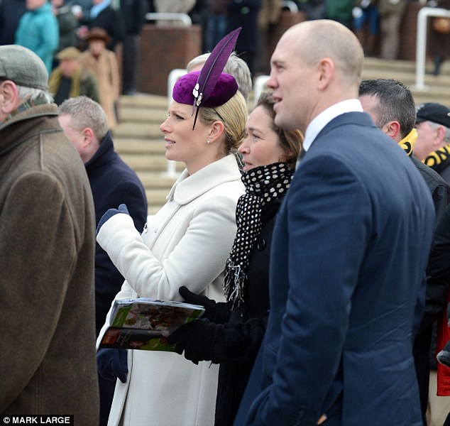 Day out: Zara Philliips and Mike Tindall watch the main race at Cheltenham on the first day of the festival